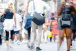 Walking people blurred image. Londoners at warm summer day. UK