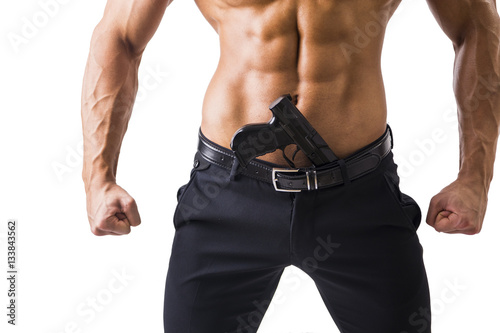 Half Body Shot Of A Handsome Athletic Man With No Shirt With Handgun