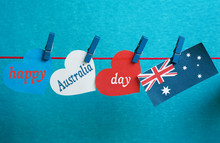 Celebrate Australia Day Holiday On January 26 With A Happy Australia Day Message Greeting Written Across White Australian Maps (red Heart) And Flag Hanging Pegs On Blue Background. Toned Collage