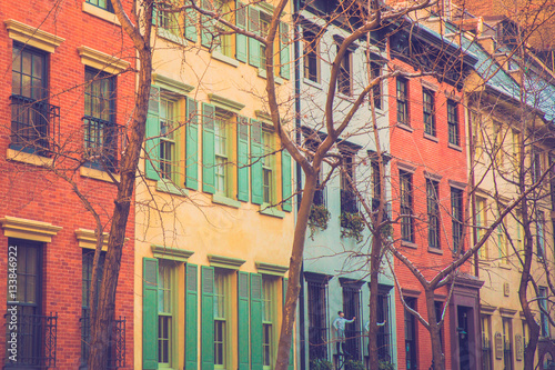 Charming Row Of Colorful Apartment Building Homes On Quaint Street In New York City With Retro