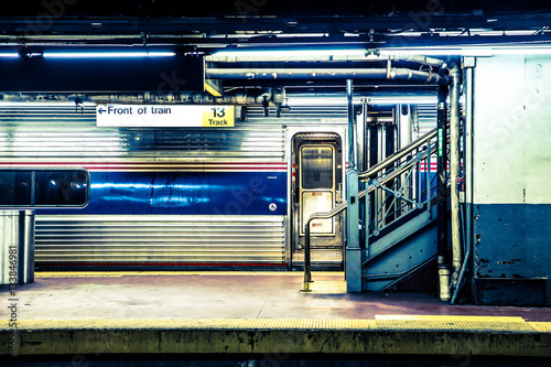 Fotomural  View of New York City train waiting at Long Island Railroad subway platform at Penn Station in Manhattan NYC