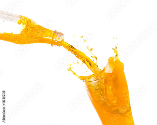 Spoed Foto op Canvas Opspattend water Pouring orange juice from bottle into glass with splashing., Isolated white background.