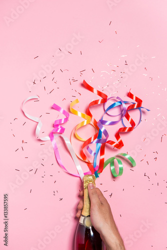 Láminas  Flat lay of Celebration. Champagne bottle with colorful party st