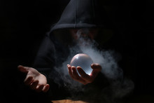 Man In A Black Hood With Cristal Ball