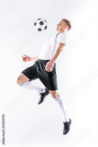 Fotografie, Obraz  Soccer player exercising with ball
