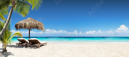 Fotobehang Strand Chairs And Umbrella In Tropical Beach - Seascape Banner