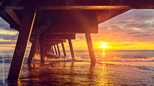 Dramatic sunset view from under pier