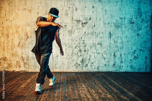 Man dancing on wall background Wallpaper Mural