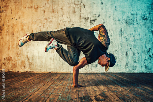 Fotografie, Obraz  Man dancing on wall background