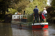Aged Couple On Narrow Boat In ...
