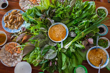 Peculiar Herbs Salad In Kon Tum, Vietnam. Using The Leaves To Make A Cone-shaped Container To Put The Food In, And Use Some Bacon, Fried Shrimp, Sliced Pork Skin, And Some Fried Rice Flour To Put In