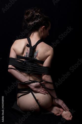 Photo  Nude woman in shirt with shibari in studio