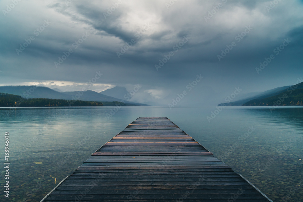Fototapety, obrazy: Dock overlooking a calm overcast lake.