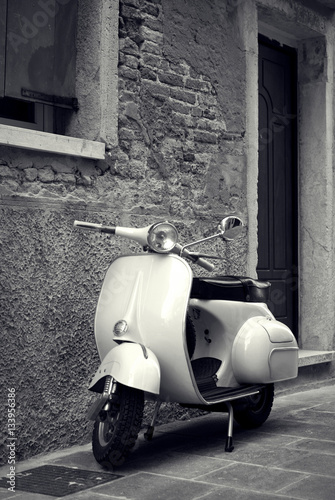 Foto op Canvas Scooter Old scooter parked in the street