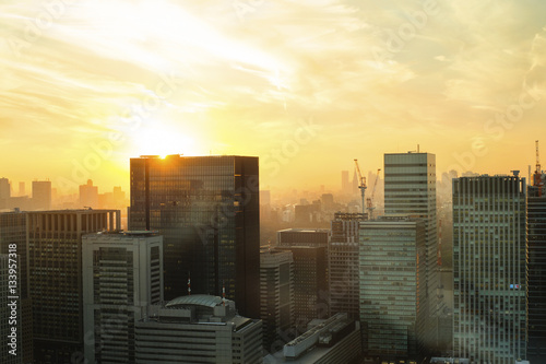 View of city buildings against sky during sunset