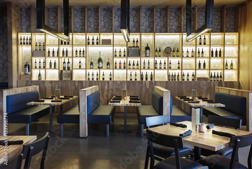 Canvas Prints Restaurant Alcohol bottles arranged on illuminated shelves in restaurant
