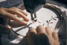 Close Up Of Woman Hands Embroidering Fabric