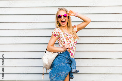 82c4ad11ff Funny cool cute beautiful hipster blonde girl posing against a white wall