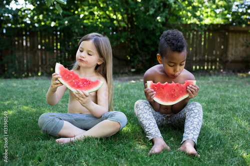 Children eating water melon slices