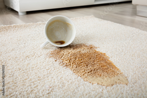 Stampa su Tela  Coffee Spilling From Cup On Carpet