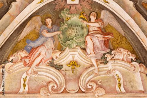 Valokuva  BRESCIA, ITALY - MAY 21, 2016: The fresco of angels as the symbol of cardinal virtue of Love in Chiesa di Santa Maria della Carita by Ferdinando Cairo and Luigi Vernazal from 18
