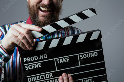 Fotografie, Tablou  Close-up of a man smiling clapperboard cinema