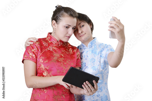 Young women with mobile devices Poster