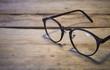 Leinwanddruck Bild - eyeglasses on wood table
