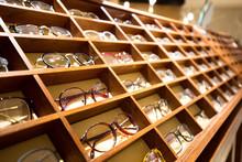 Eyeglasses In Wooden Rack