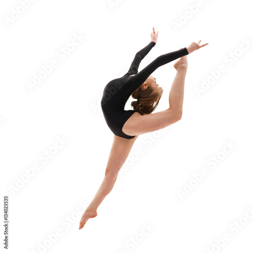 Spoed Foto op Canvas Gymnastiek Young gymnast in elegant jump studio shot