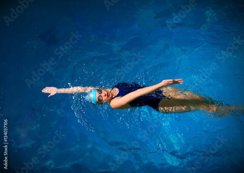 Young woman swimmer Wallpaper Mural