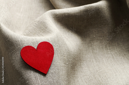 Wooden heart on linen fabric Wallpaper Mural
