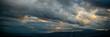 Leinwanddruck Bild - Heavy clouds over mountains