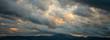 Leinwandbild Motiv Heavy clouds over mountains
