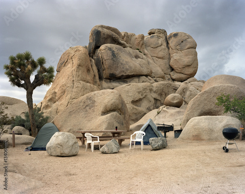 Papiers peints Camping Camping equipment on field by rock formations at Joshua Tree National Park