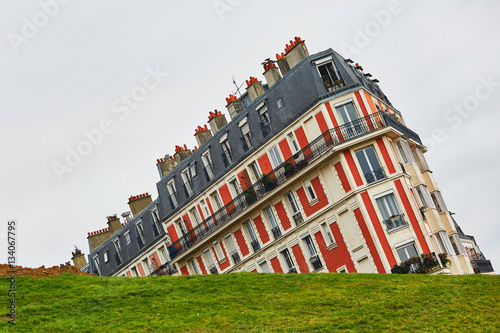 Obraz Funny picture of a building on Montmartre hill taken with unusual angle, Paris, France - fototapety do salonu
