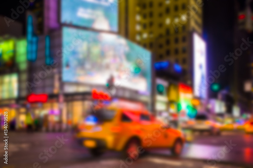Poster New York TAXI New York City night street scene defocused blur with lights and taxi.