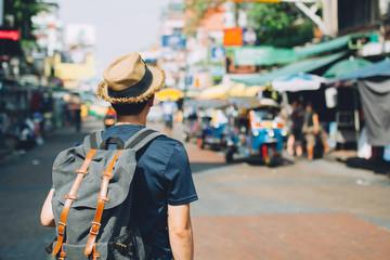 Fototapeta Young Asian traveling backpacker in Khaosan Road outdoor market