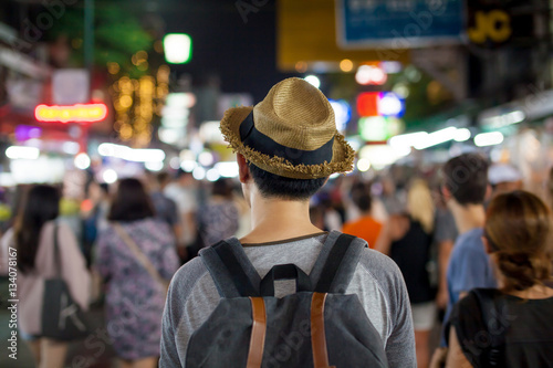 Spoed Fotobehang Japan Young Asian traveling backpacker in Khaosan Road night market
