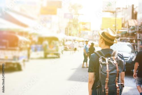 Young Asian traveling backpacker in Khaosan Road outdoor market Wallpaper Mural