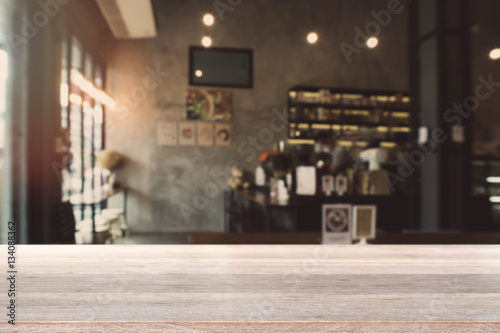 Wood Table Top And Blurred Bokeh Cafe And Coffee Shop Interior