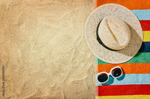 Fotografie, Obraz  Top view of sandy beach with towel frame and summer accessories