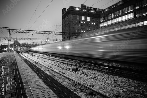 Black and white photo the train at night on long exposure railway station Poster