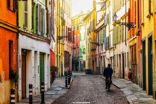 Foto auf Leinwand Schmale Gasse Old scenic street in Parma, Emilia-Romagna, Italy.