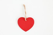 Red Wooden Heart Shaped Tag With Rope Isolated On White