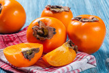 Persimmons on table