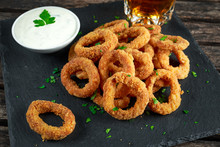Fried Breaded Onion Rings With Sauce And Beer