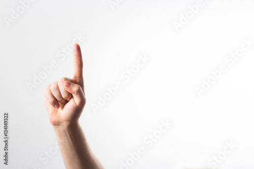 Foto  hand finger pointing upward isolated on a white background, in a
