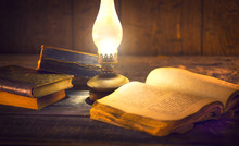 Old Oil Lamp And Old Books In ...