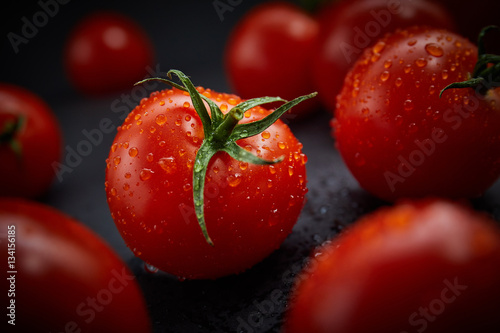Fotografie, Obraz  Fresh cherry tomatoes on black background